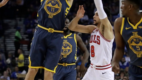 <p>               Golden State Warriors' Klay Thompson, left, shoots past Chicago Bulls' Zach LaVine (8) during the first half of an NBA basketball game Friday, Jan. 11, 2019, in Oakland, Calif. (AP Photo/Ben Margot)             </p>