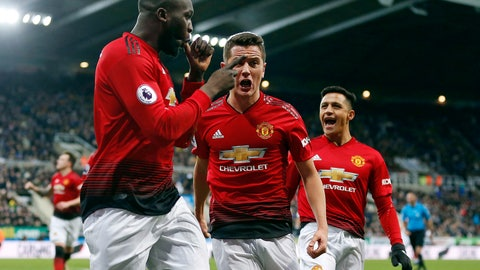 <p>               Manchester United's Romelu Lukaku, left, celebrates with teammates after scoring his side's first goal of the game against Newcastle United during a Premier League soccer match at St James' Park, Wednesday, Jan. 2, 2019, in Newcastle, England. (Owen Humphreys/PA via AP)             </p>