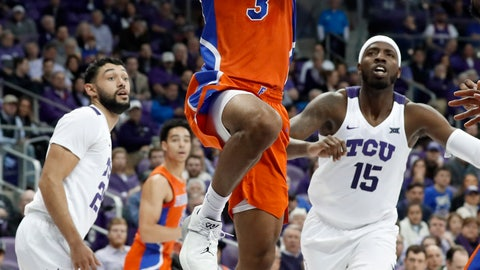<p>               Florida guard Jalen Hudson (3) breaks to the basket after getting past TCU's Alex Robinson, left, and JD Miller (15) in the first half of an NCAA college basketball game in Fort Worth, Texas, Saturday, Jan. 26, 2019. (AP Photo/Tony Gutierrez)             </p>