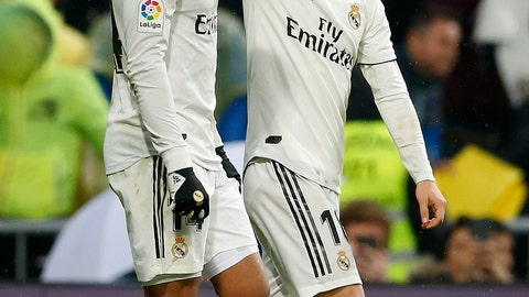 <p>               Real Madrid's Luka Modric, right, celebrates his goal with his teammate Casemiro during the La Liga soccer match between Real Madrid and Sevilla at the Bernabeu stadium in Madrid, Spain, Saturday, Jan. 19, 2019. (AP Photo/Andrea Comas)             </p>
