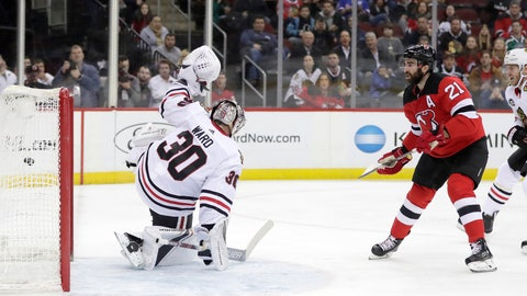<p>               New Jersey Devils right wing Kyle Palmieri (21) scores a goal on Chicago Blackhawks goaltender Cam Ward (30) during the second period of an NHL hockey game, Monday, Jan. 14, 2019, in Newark, N.J. (AP Photo/Julio Cortez)             </p>