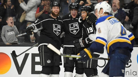 <p>               Los Angeles Kings center Anze Kopitar, second from left, celebrates his goal with defenseman Jake Muzzin, left, and left wing Alex Iafallo, second from right, as St. Louis Blues defenseman Carl Gunnarsson skates by during the second period of an NHL hockey game Monday, Jan. 21, 2019, in Los Angeles. (AP Photo/Mark J. Terrill)             </p>