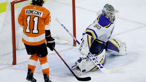 <p>               St. Louis Blues' Jordan Binnington (50) blocks a shot as Philadelphia Flyers' Travis Konecny (11) looks for a rebound during the third period of an NHL hockey game, Monday, Jan. 7, 2019, in Philadelphia. (AP Photo/Matt Slocum)             </p>