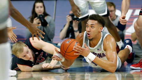 <p>               Arizona center Chase Jeter, right, and Utah guard Parker Van Dyke battle for a loose ball in the first half during an NCAA college basketball game, Saturday, Jan. 5, 2019, in Tucson, Ariz. (AP Photo/Rick Scuteri)             </p>