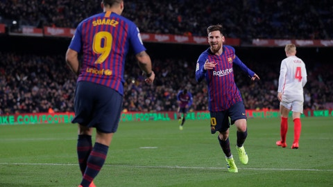 <p>               FC Barcelona's Lionel Messi celebrates after scoring during a Spanish Copa del Rey soccer match between FC Barcelona and Sevilla at the Camp Nou stadium in Barcelona, Spain, Wednesday, Jan. 30, 2019. (AP Photo/Manu Fernandez)             </p>