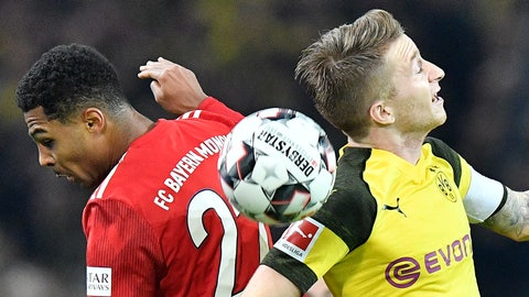 <p>               In this Saturday, Nov. 10, 2018, file photo, Bayern's Serge Gnabry, left, and Dortmund's Marco Reus challenge for the ball during the German Bundesliga soccer match between Borussia Dortmund and Bayern Munich in Dortmund, Germany. (AP Photo/Martin Meissner)             </p>