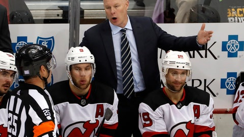 <p>               FILE - In this Nov. 5, 2018, file photo, New Jersey Devils head coach John Hynes talks with referee Marc Joannette (25) during the third period of an NHL hockey game against the Pittsburgh Penguins, in Pittsburgh. The New Jersey Devils have given coach John Hynes a multiyear contract extension. The team announced the deal Thursday, Jan. 3, 2019, saying Hynes' leadership has been instrumental in building a culture and systems for the development of the players. (AP Photo/Gene J. Puskar, File)             </p>