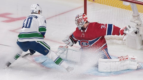 <p>               Vancouver Canucks' Elias Pettersson moves in on Montreal Canadiens goaltender Carey Price during the first period of an NHL hockey game Thursday, Jan. 3, 2019, in Montreal. (Graham Hughes/The Canadian Press via AP)             </p>