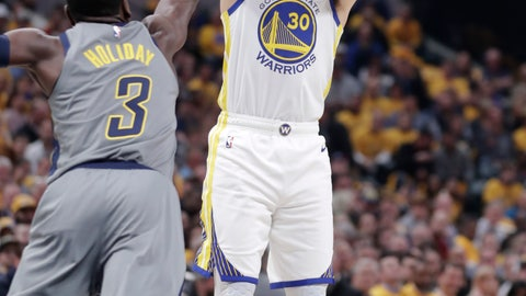 <p>               Golden State Warriors guard Stephen Curry (30) shoots over Indiana Pacers guard Aaron Holiday (3) during the first half of an NBA basketball game in Indianapolis, Monday, Jan. 28, 2019. (AP Photo/Michael Conroy)             </p>