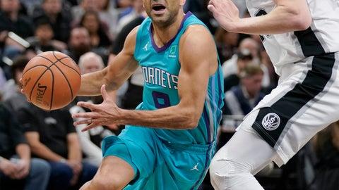 <p>               Charlotte Hornets' Tony Parker, left, drives against San Antonio Spurs' Davis Bertans during the first half of an NBA basketball game, Monday, Jan. 14, 2019, in San Antonio. (AP Photo/Darren Abate)             </p>