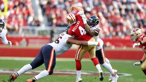 <p>               FILE - In this Dec. 23, 2018, file photo, San Francisco 49ers quarterback Nick Mullens (4) is hit by Chicago Bears defensive end Akiem Hicks, left, and outside linebacker Khalil Mack during the second half of an NFL football game in Santa Clara, Calif.  An already strong Bears defense got only better with the acquisition of elite pass rusher Mack before the season. With Mack and Akiem Hicks wreaking havoc up front and Eddie Jackson and Kyle Fuller providing big plays from the secondary, the Bears allowed the fewest points in the NFL this season and appear to have the defense best equipped for a long postseason run starting with Sunday's home game against defending champion Philadelphia. (AP Photo/D. Ross Cameron, File)             </p>