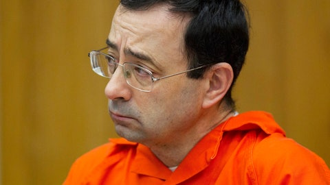 <p>               FILE - In this Jan. 31, 2018, file photo, Larry Nassar appears for his sentencing at Eaton County Circuit Court in Charlotte, Mich. A U.S. Education report is blasting Michigan State University's handling of sexual assaults related to the investigation of now-imprisoned sports doctor Nassar and other campus crime. The Lansing State Journal reports Wednesday, Jan. 30, 2019, that Education officials have been looking into the East Lansing school's compliance with the Clery Act which requires notifying the campus community about crimes in a timely manner. (Cory Morse/The Grand Rapids Press via AP, File)             </p>