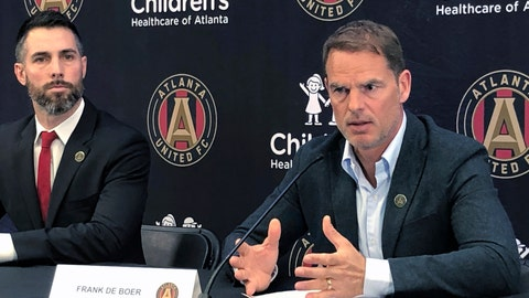 <p>               New Atlanta United coach Frank de Boer, right, speaks at an introductory news conference while the team's technical director, Carlos Bocanegra, looks on, Monday, Jan. 14, 2019. De Boer is looking to revive his coaching career with the MLS Cup champions after short stints in his two previous jobs at Crystal Palace and Inter Milan. (AP Photo/Paul Newberry)             </p>