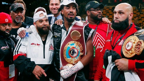 <p>               FILE - In this Oct. 21, 2018, file photo, Demetrius Andrade, center, stands with members of his team after defeating Walter Kautondokwa in a WBO middleweight championship boxing match in Boston. Andrade is just a few months from winning a middleweight title but perhaps still far away from fights with the division's biggest names. Canelo Alvarez, Gennady Golovkin and Daniel Jacobs are the headliners at 160 pounds, and while perhaps one or more of them could someday be in Andrade's future, it doesn't appear to be the near future. (AP Photo/Michael Dwyer, File)             </p>