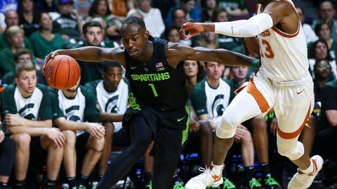 <p>               FILE - In this Nov. 23, 2018, file photo, Michigan State's Joshua Langford (1) moves the ball around Texas' Jase Febres during the second half of an NCAA college basketball game in Las Vegas. Langford will miss the rest of the season because of his injured ankle. Spartans coach Tom Izzo says in a statement Wednesday, Jan. 30, that the junior will likely need surgery. Langford has missed the last eight games. In the 13 games he did play--all starts--Langford averaged 15 points. (AP Photo/Chase Stevens, File)             </p>