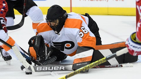 <p>               Philadelphia Flyers goaltender Mike McKenna reaches for the puck during the second period of the team's NHL hockey game against the Washington Capitals, Tuesday, Jan. 8, 2019, in Washington. The Capitals won 5-3. (AP Photo/Nick Wass)             </p>