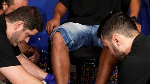 <p>               Brazil's former soccer player Ronaldinho Gaucho places his feet on a mold to make a plaque of his footprints to be placed on Brazil's Soccer Walk of Fame at Maracana stadium in Rio de Janeiro, Brazil, Tuesday, Jan. 8, 2019.  Ronaldinho was twice named FIFA World Player of the Year. (AP Photo/Leo Correa)             </p>