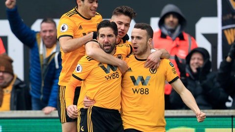 <p>               Wolverhampton Wanderers' Diogo Jota, right, celebrates with teammates scoring his side's first goal of the game during the English Premier League soccer match between Wolverhampton Wanderers and Leicester at Molineux, Wolverhampton, England, Saturday, Jan. 19, 2019. (Mike Egerton/PA via AP)             </p>