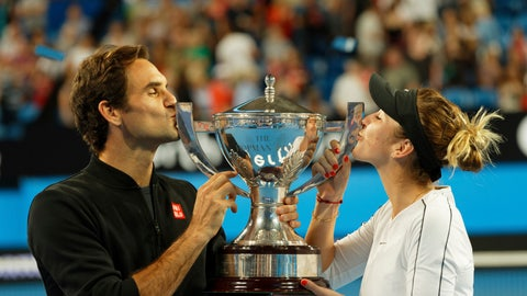 <p>               Switzerland's Roger Federer and Belinda Bencic kiss the trophy after winning the final against Alexander Zverev and Angelique Kerber of Germany at the Hopman Cup in Perth, Australia, Saturday Jan. 5, 2019. (AP Photo/Trevor Collens)             </p>
