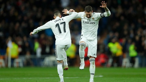 <p>               Real Madrid's Lucas Vazquez, left, celebrates after scoring with his teammate Sergio Ramos his side's first goal during a Spanish Copa del Rey soccer match between Real Madrid and Girona at the Bernabeu stadium in Madrid, Spain, Thursday, Jan. 24, 2019. (AP Photo/Manu Fernandez)             </p>