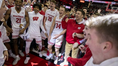 <p>               Wisconsin players and fans celebrate Wisconsin's 64-54 upset victory over Michigan in an NCAA college basketball game Saturday, Jan. 19, 2019, in Madison, Wis. (AP Photo/Andy Manis)             </p>