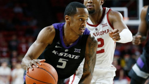 <p>               Kansas State guard Barry Brown Jr. (5) drives past Oklahoma guard Aaron Calixte (2) during the first half of an NCAA college basketball game in Norman, Okla., Wednesday, Jan. 16, 2019. (AP Photo/Sue Ogrocki)             </p>