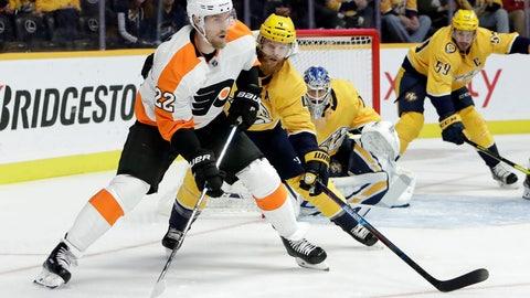 <p>               Philadelphia Flyers right wing Dale Weise (22) moves the puck as Nashville Predators defenseman Ryan Ellis (4) follows during the first period of an NHL hockey game Tuesday, Jan. 1, 2019, in Nashville, Tenn. (AP Photo/Mark Humphrey)             </p>