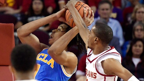 <p>               Southern California guard Shaqquan Aaron, right, blocks the shot of UCLA center Moses Brown during the first half of an NCAA college basketball game Saturday, Jan. 19, 2019, in Los Angeles. (AP Photo/Mark J. Terrill)             </p>