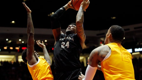 <p>               Nevada forward Jordan Caroline, center, goes up for a shot as New Mexico's Corey Manigault, left, and Vance Jackson defend during the first half of an NCAA college basketball game in Albuquerque, N.M., Saturday, Jan. 5, 2019. (AP Photo/Andres Leighton)             </p>
