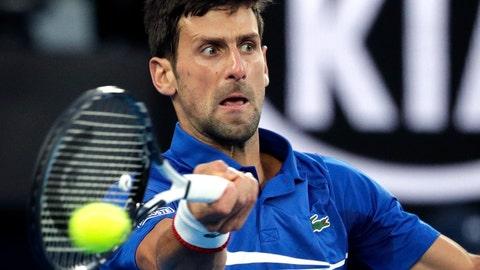 <p>               Serbia's Novak Djokovic makes a forehand return to Japan's Kei Nishikori during their quarterfinal match at the Australian Open tennis championships in Melbourne, Australia, Wednesday, Jan. 23, 2019. (AP Photo/Aaron Favila)             </p>