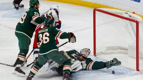 <p>               Minnesota Wild goalie Devan Dubnyk, right, stops a shot as Nick Seeler and Greg Pateryn, left, keep Columbus Blue Jackets' Nick Foligno away in the first period of an NHL hockey game Saturday, Jan. 19, 2019, in St. Paul, Minn. (AP Photo/Jim Mone)             </p>