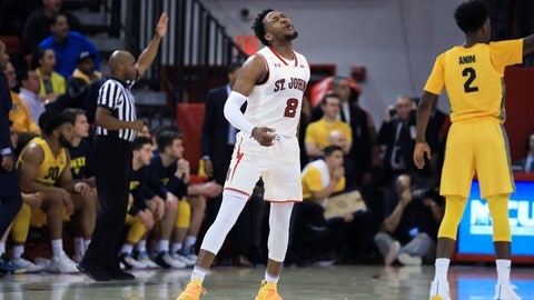 <p>               St. John's guard Shamorie Ponds winces after missing a shot during the first half of an NCAA college basketball game against Marquette on Tuesday, Jan. 1, 2019, in New York. (AP Photo/Kevin Hagen).             </p>