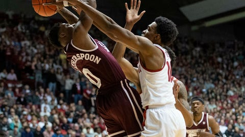 <p>               Mississippi State guard Nick Weatherspoon (0) struggles to pass the ball away from Alabama guard Herbert Jones (10) during the first half of an NCAA college basketball game, Tuesday, Jan. 29, 2019, in Tuscaloosa, Ala. (AP Photo/Vasha Hunt)             </p>