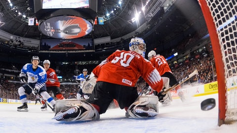 <p>               Finland's Aleksi Heponiemi, left, watches as Aarne Talvitie, not seen, scores on Switzerland's Luca Hollenstein (30) during a world junior hockey championships semifinal in Vancouver, British Columbia, Friday, Jan. 4, 2019. (Minas Panagiotakis/Pool Photo via AP)             </p>