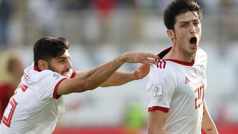 <p>               Iran's forward Sardar Azmoun, right, celebrates after scoring his side's second goal during the AFC Asian Cup group D soccer match between Iran and Vietnam at Al Nahyan Stadium in Abu Dhabi, United Arab Emirates, Saturday, Jan. 12, 2019. (AP Photo/Kamran Jebreili)             </p>