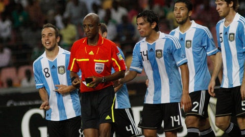 <p>               FILE - In this Wednesday, June 1, 2011 file photo, referee Ibrahim Chaibou, second left, is surrounded by Argentina soccer players after he awarded a penalty against them during an international friendly soccer match with Nigeria Super eagles at the National stadium in Abuja, Nigeria. An international soccer referee who has long been implicated in fixing matches has been banned for life for taking bribes, it was reported on Thursday, Jan. 24, 2019. FIFA says its ethics committee judges found Ibrahim Chaibou guilty of taking bribes and also fined him 200,000 Swiss francs ($201,000). (AP Photo/Sunday Alamba, file)             </p>