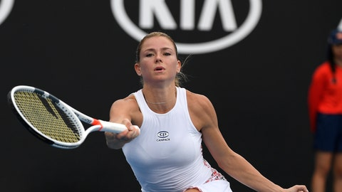 <p>               Italy's Camila Giorgi makes a forehand return to Poland's Iga Swiatek during their second round match at the Australian Open tennis championships in Melbourne, Australia, Thursday, Jan. 17, 2019. (AP Photo/Andy Brownbill)             </p>