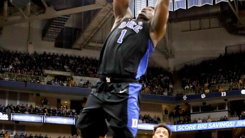 <p>               Duke's Zion Williamson (1) goes up for during a dunk in front of Pittsburgh's Terrell Brown (21) during the first half of an NCAA college basketball game, Tuesday, Jan. 22, 2019, in Pittsburgh. (AP Photo/Keith Srakocic)             </p>