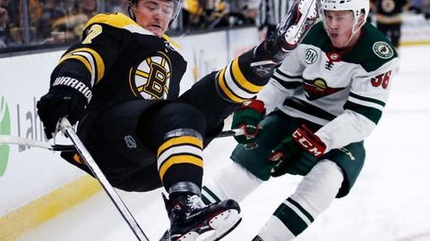 <p>               Boston Bruins center Ryan Donato, left, goes airborne after being hit by Minnesota Wild defenseman Nick Seeler during the second period of an NHL hockey game in Boston, Tuesday, Jan. 8, 2019. (AP Photo/Charles Krupa)             </p>