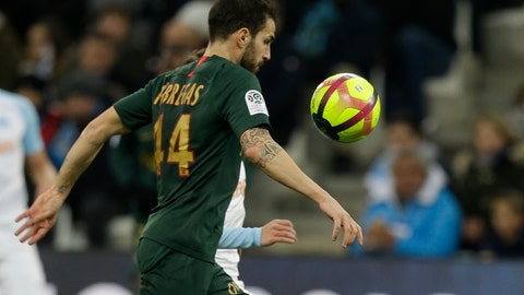<p>               Monaco midfielder Cesc Fabregas challenges for the ball during the League One soccer match between Marseille and Monaco at the Velodrome stadium, in Marseille, southern France, Sunday, Jan. 13, 2019. (AP Photo/Claude Paris)             </p>