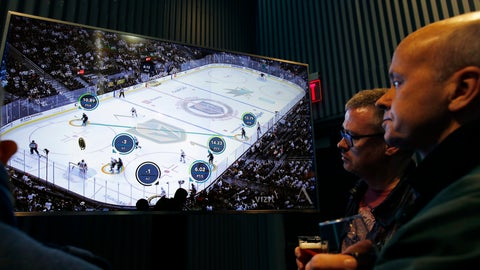 <p>               People watch real-time puck and player tracking technology on display during an NHL hockey game between the Vegas Golden Knights and the San Jose Sharks, in Las Vegas, Thursday, Jan. 10, 2019. The NHL for the first time has tested real-time puck and player tracking in regular-season games with the aim of having it ready for the 2019-20 season. Microchips were added to players' shoulder pads and fitted inside specially designed pucks for two Vegas Golden Knights home games this week: Tuesday against the New York Rangers and Thursday against the San Jose Sharks. Antennas stationed around the arena tracked the players and the puck through radio frequencies and beamed the data to a suite where league and Players' Association executives and representatives from 20 teams and various technology firms, sports betting companies and TV rights holders were on hand for the two nights of testing.(AP Photo/John Locher)             </p>