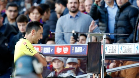 <p>               FILE - In this Sunday, Oct. 28, 2018 file photo, referee Jose Maria Sanchez Martinez checks the Video Assistant Referee VAR during the Spanish La Liga soccer match between FC Barcelona and Real Madrid at the Camp Nou stadium in Barcelona, Spain. The video review system's debut in its first season in Spain had not prompted major discussions early on, but two controversial decisions involving powerhouses Real Madrid and Barcelona were enough to make it a hot topic. (AP Photo/Joan Monfort, File)             </p>