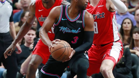 <p>               Miami Heat guard Dwyane Wade (3) looks for an opening past Washington Wizards center Ian Mahinmi, left, and forward Sam Dekker during the first half of an NBA basketball game, Friday, Jan. 4, 2019, in Miami. (AP Photo/Wilfredo Lee)             </p>
