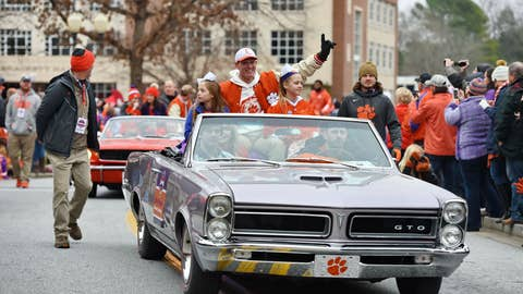<p>               Defensive head coach Brent Venables, along with family members ride in the parade honoring Clemson Saturday, Jan. 12, 2019, in Clemson, S.C.,  The Tigers defeated Alabama 44-16 in the College Football Playoff championship game Monday Jan. 7. (AP Photo/Richard Shiro)             </p>