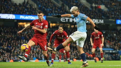 <p>               Manchester City's Sergio Aguero, right, shoots and scores the opening goal of the game during their English Premier League soccer match between Manchester City and Liverpool at the Ethiad stadium, Manchester England, Thursday, Jan. 3, 2019. (AP Photo/Jon Super)             </p>