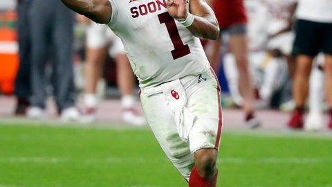 <p>               FILE - In this Dec. 29, 2018, file photo, Oklahoma quarterback Kyler Murray throws a pass during the second half of the Orange Bowl NCAA college football game against Alabama in Miami Gardens, Fla. The Oakland Athletics remain hopeful of seeing Heisman Trophy winner Murray in their baseball uniform when spring training begins next month. While the Oklahoma quarterback declared for the NFL draft last week, the prized outfielder could report to A's spring training in Mesa, Arizona--and he has an invite to big league camp. (AP Photo/Wilfredo Lee, File)             </p>