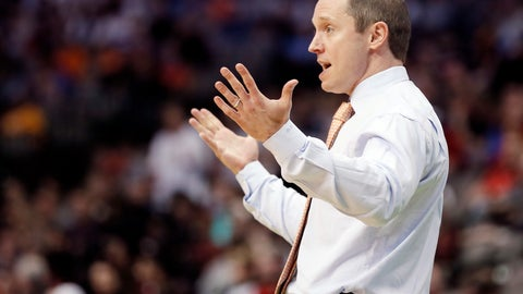 """<p>               FILE - In this March 15, 2018, file photo, Florida head coach Mike White gestures during the first half of a first-round game against St. Bonaventure at the NCAA college basketball tournament in Dallas. Florida coach Mike White says he has a team of """"clock-watchers,"""" guys seemingly content to coast through the final minutes of games and hope to win. It's the only way he can explain how the Gators have struggled down the stretch in Southeastern Conference play. (AP Photo/Brandon Wade, File)             </p>"""
