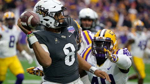 <p>               UCF quarterback Darriel Mack Jr. (8) throws the ball away while being pressured by LSU linebacker Devin White (40) in the first half during the Fiesta Bowl NCAA college football game, Tuesday, Jan. 1, 2019, in Glendale, Ariz. (AP Photo/Rick Scuteri)             </p>
