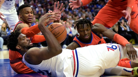 <p>               Philadelphia 76ers' Joel Embiid (21) grabs a loose ball next to Oklahoma City Thunder's Russell Westbrook, back left, and Jerami Grant during the second half of an NBA basketball game Saturday, Jan. 19, 2019, in Philadelphia. The Thunder beat the 76ers 117-115. (AP Photo/Michael Perez)             </p>