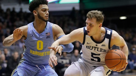 <p>               Butler's Paul Jorgensen (5) is defended by Marquette's Markus Howard (0) during the first half of an NCAA college basketball game, Wednesday, Jan. 30, 2019, in Indianapolis. (AP Photo/Darron Cummings)             </p>